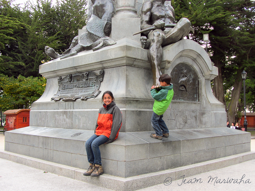 two children next to a monument