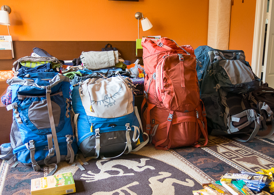 four packed backpacks