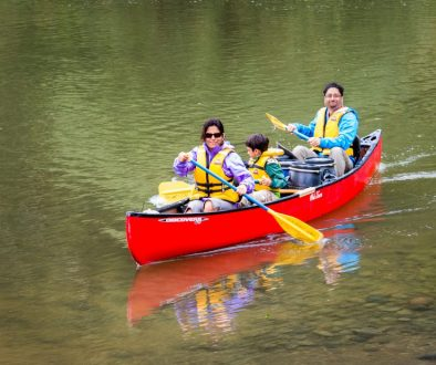a family on a canoe in a water body