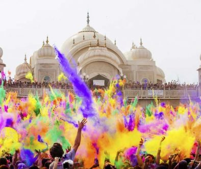 lots of people throwing colors and celebrating holi festival