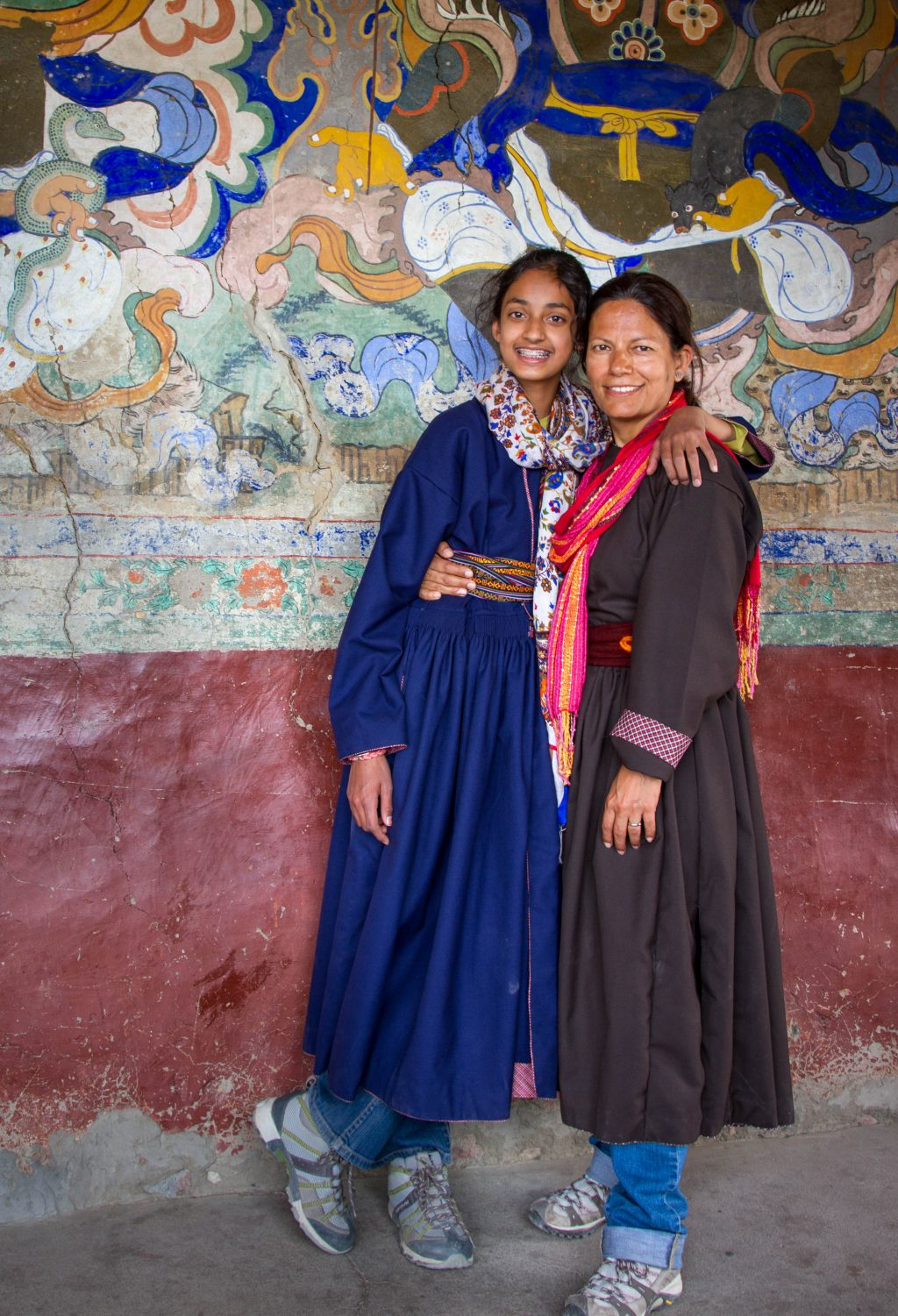 one girl and one woman in traditional ladakhi dress