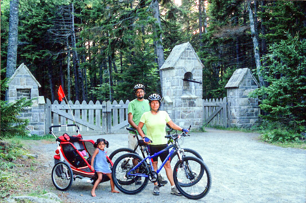 a family with the bikes and trailer