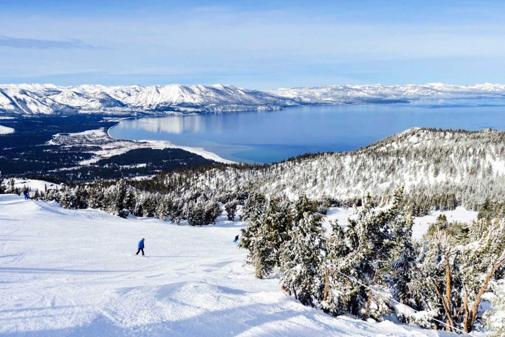Lake Tahoe in the background of a skier