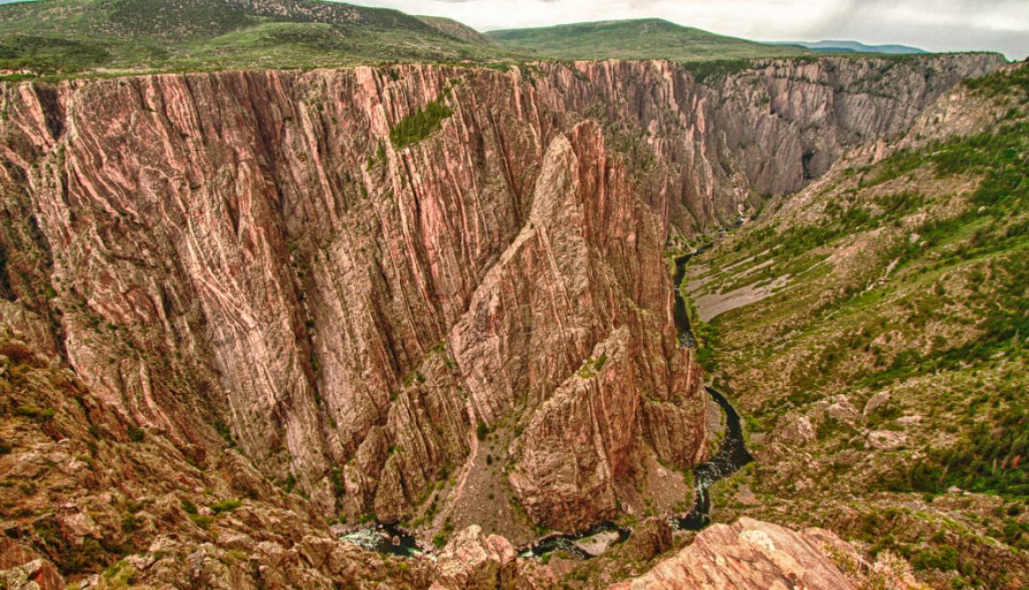 canyon with river running through black canyon of the gunnison national park less crowded national parks