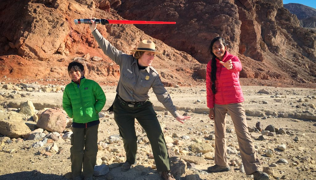 park ranger and two kids making silly poses from star wars