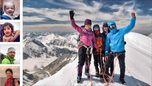 family of four enjoying outdoor adventure on top of the moutain