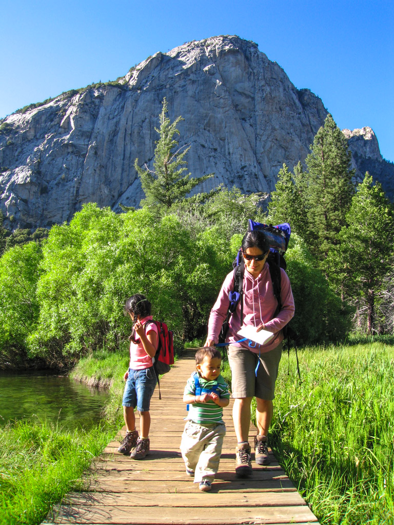 family hiking in the meadow