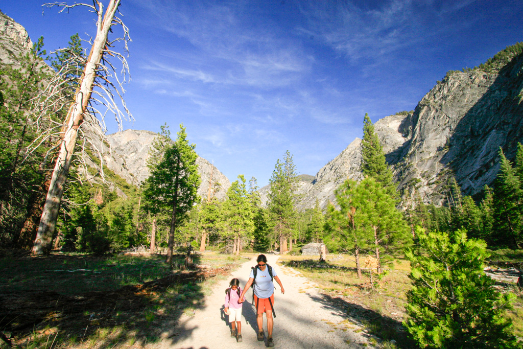 a woman and girl walking in the mountains kings canyon national park