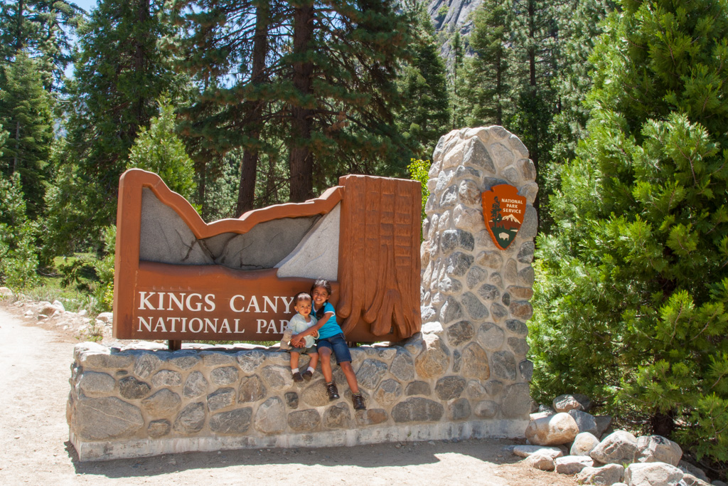 two children in front of a board kings canyon national park