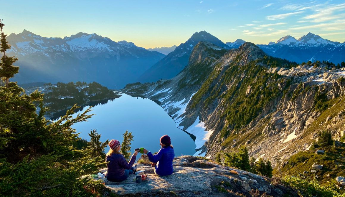 two women sitting in the mountains north cascades national park