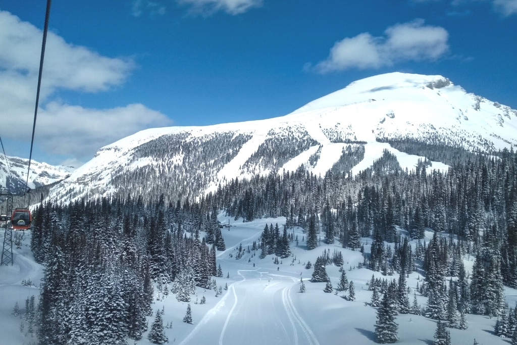 snow covered mountain with ski lift