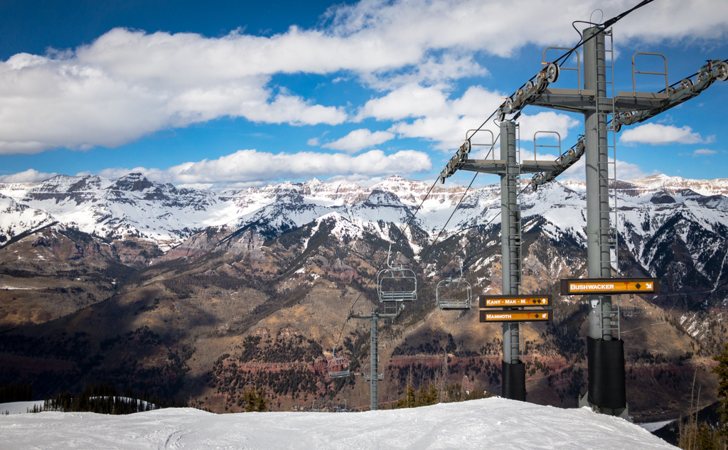 snow covered mountains with ski lifts