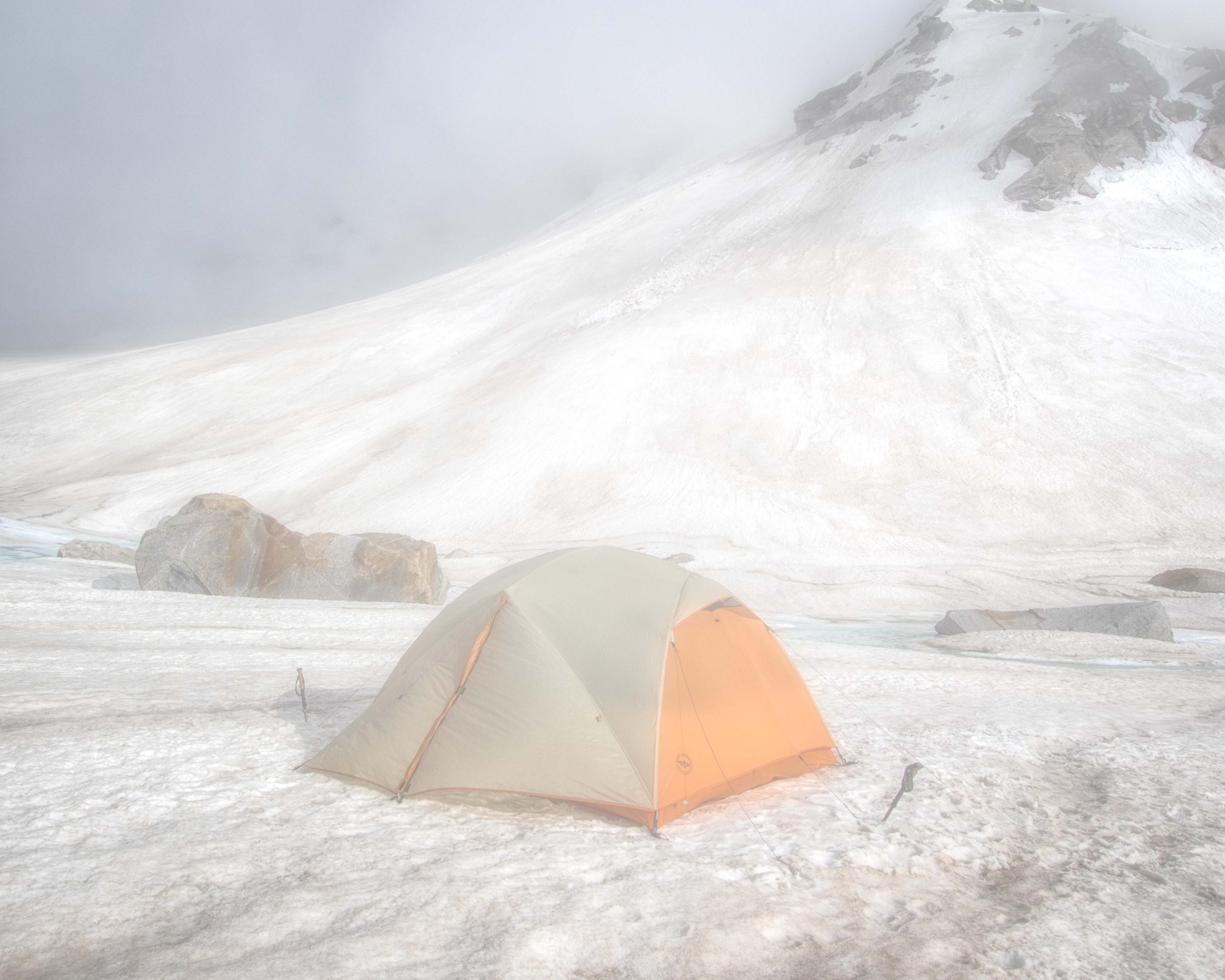 a tent on the snowy mountains