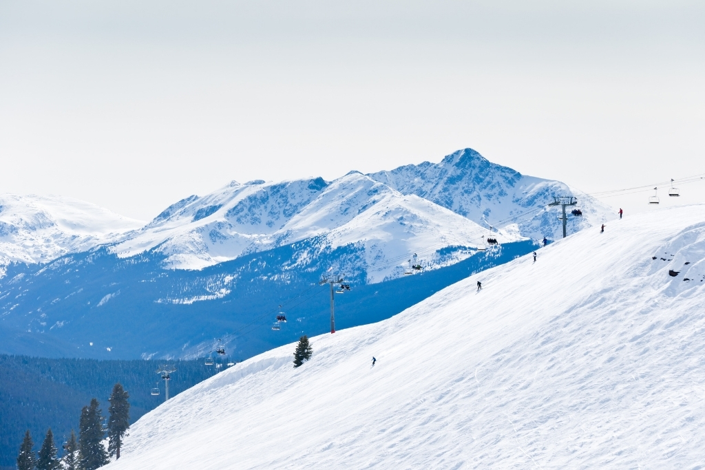 skiers on snow covered mountain